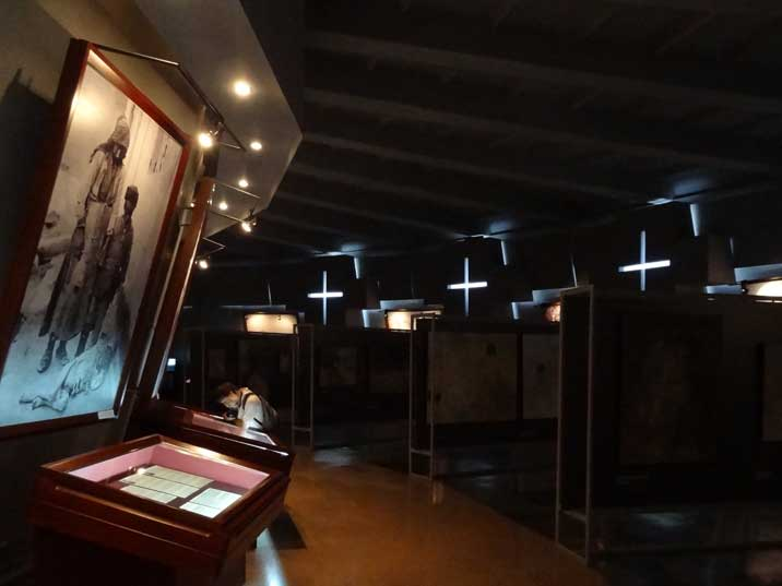 The circle shaped exhibition room of the Armenian Genocide Museum with many photos, documents and video material