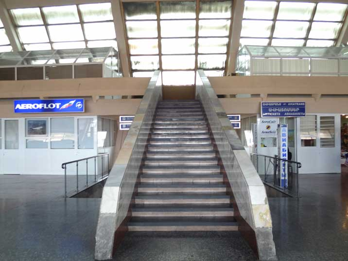 Stairway leading to the upper ring inside the terminal of Zvartnots Airport in Yerevan