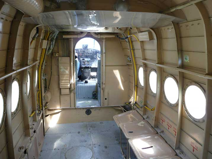 Looking into the An-2 cockpit from the passenger compartment