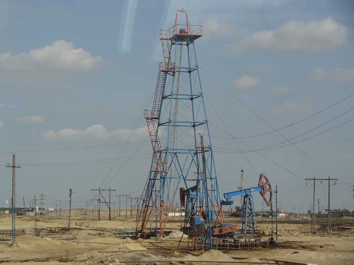 A oil derrick and a nodding donkey seen on the Absheron Peninsula where much of Azerbaijan's oil is produced