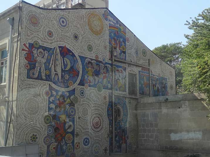 Soviet Fresco on a house in Baku depicting children from all nations, cosmonauts and peace doves