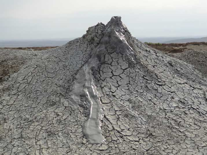 A Gobustan mud volcanoes, a constant flow of mud that has medicinal qualities bubbles up trough these volcanoes