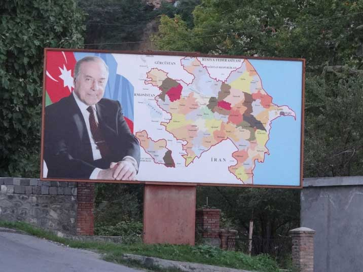 Large billboard with the great Azeri Leader Heydar Aliyev and a map of the country with its provinces