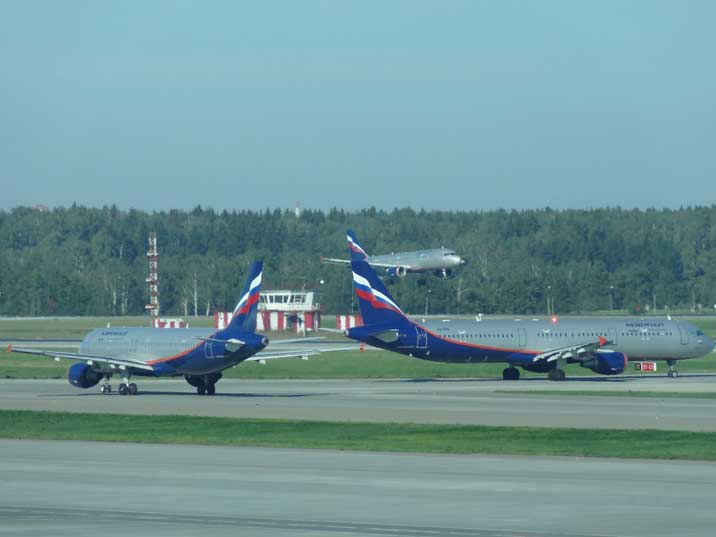 Two Aeroflot aircraft taxing to the runway and on landing on Sheremetyevo International Airport in Moscow