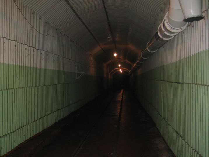 A long tunnel fortified with concrete slabs inside the complex