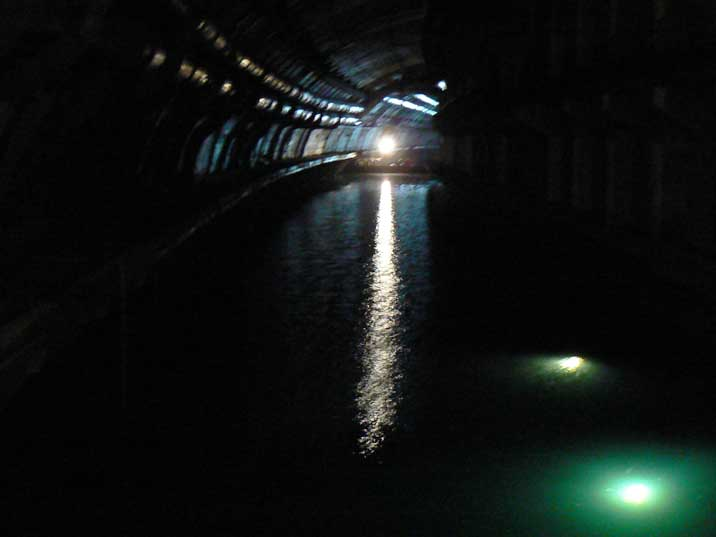 Dark curved water tunnel inside the Balaklava submarine base