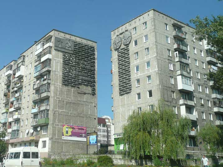 Soviet era flats decorated with hammer and sickle propaganda
