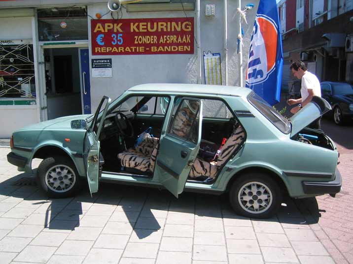 Our Skoda car receiving some oil and air in the original Barum tyres produced in Czechoslovakia