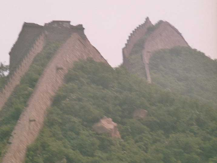 The Chinese wall stretching the rugged hilly Mutianyu terrain