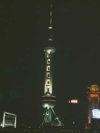 The famous Oriental Pearl Tower on the Huangpu River at night
