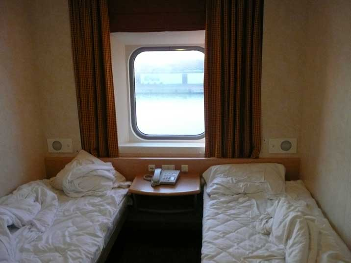 First class cabin with a window on the ferry to Helsinki