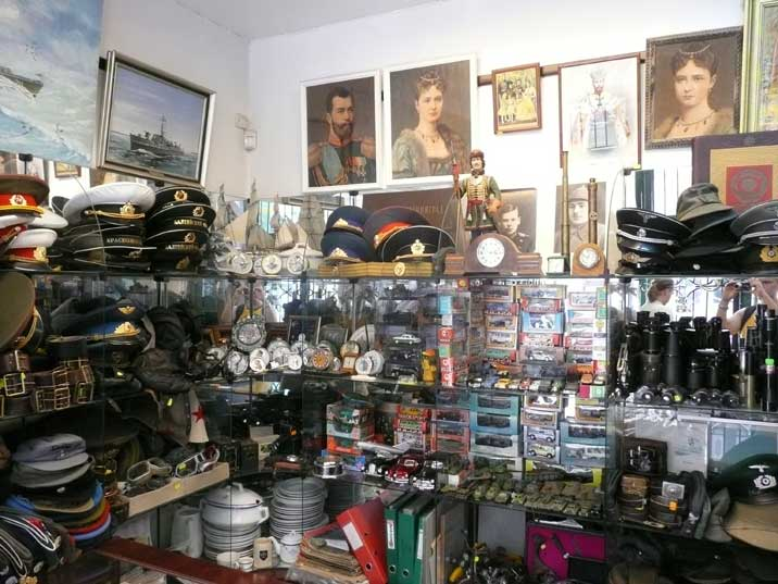 Soviet army hats, model cars, binoculars, clocks and paintings