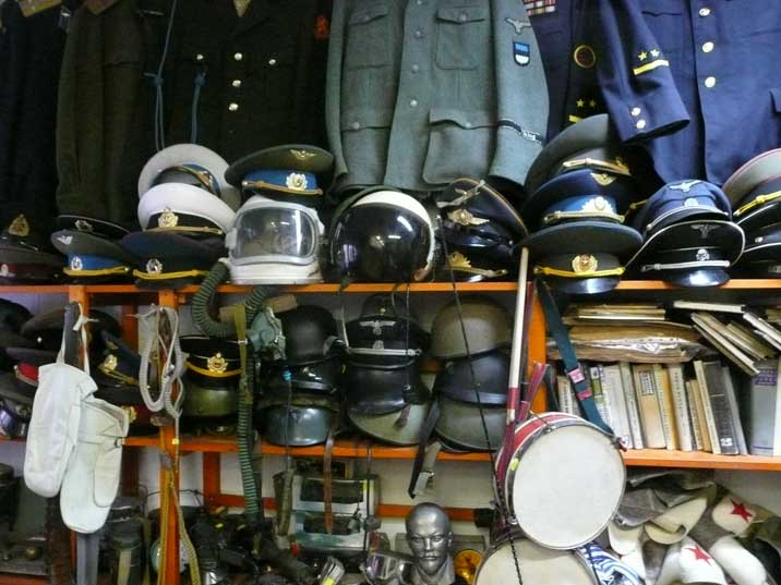 Red Army uniforms, caps and pilot helmets in the antique shop