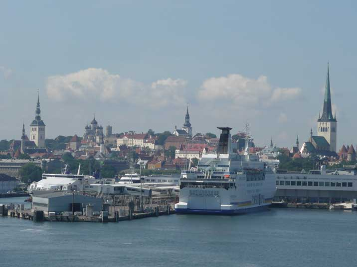 Ferries and Cruise ships with old Tallinn in the background