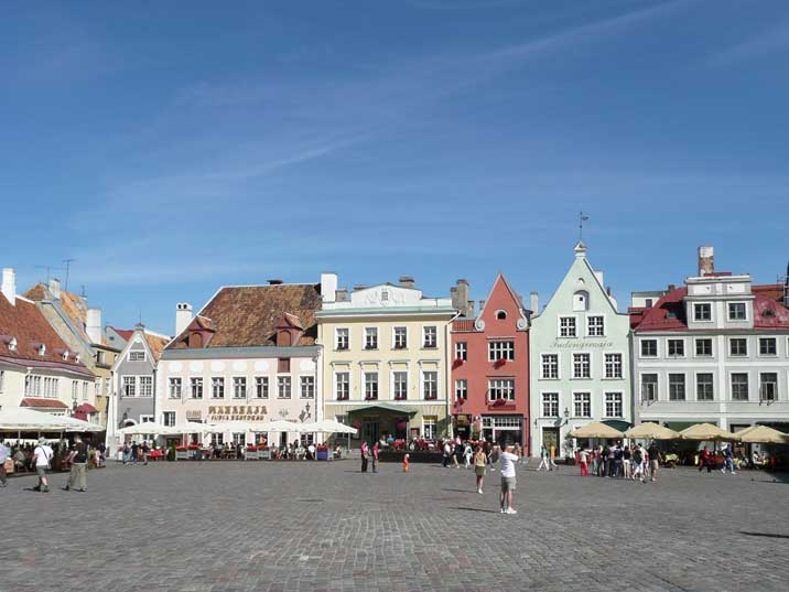 Tourists enjoying terraces and shops on Raekoja Plats in Tallinn