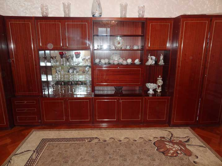 A cabinet that could be found in many Soviet households filled with various pieces of china in our hotel room in Kutaisi
