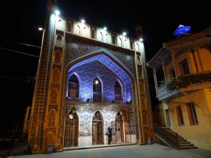 Entrance to a Abanotubani bathhouse beautifully decorated with blue mosaics giving it s silk road touch