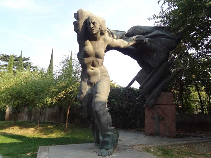 Heroic statue of a half naked Soviet female warrior in the 9th of April Park in the Tbilisi city centre