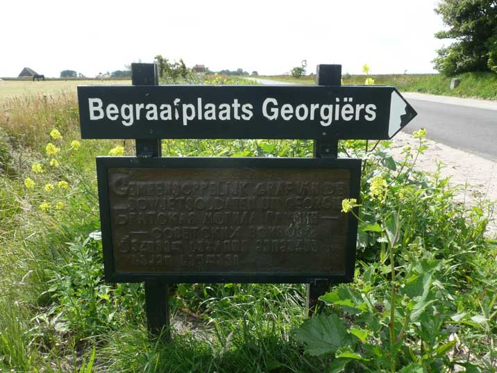 Sign to the cemetery where 476 Georgian soldiers are buried