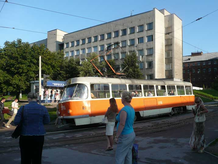 People waiting for a tram in a Kaliningrad residential area