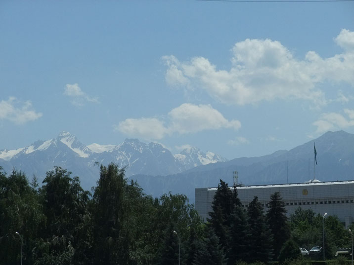The snow capped Chimbulak mountains with the Almaty Akimat in the foreground