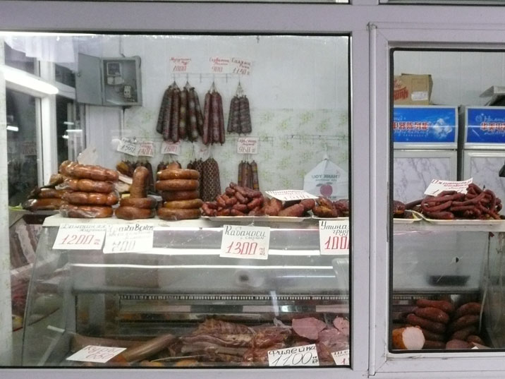 A large variety of meat and sausages on sale in a store near the Almaty market