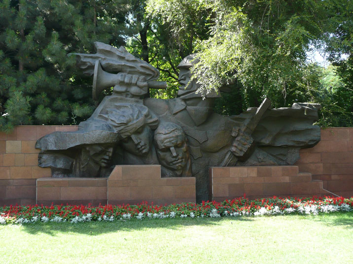 Large sculpture that is part of the World War II memorial depicting a Red soldier and civilians