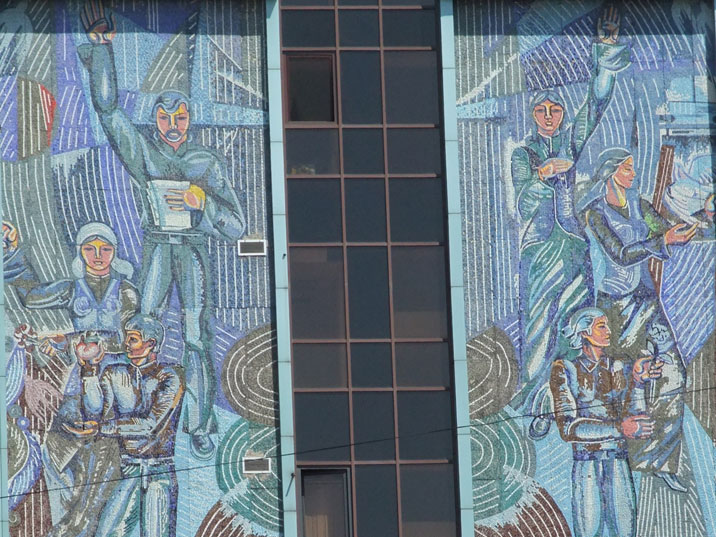 A Soviet era wall fresco depicting workers farmers and artists all longing for peace