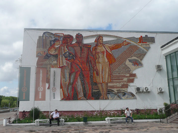 Soviet era wall mosaic depicting miners and a woman in the Karaganda city centre