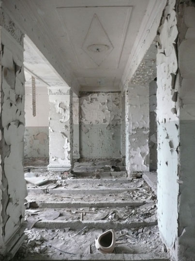 Once a corridor in a busy Soviet administrate office, now abandoned an left to the elements
