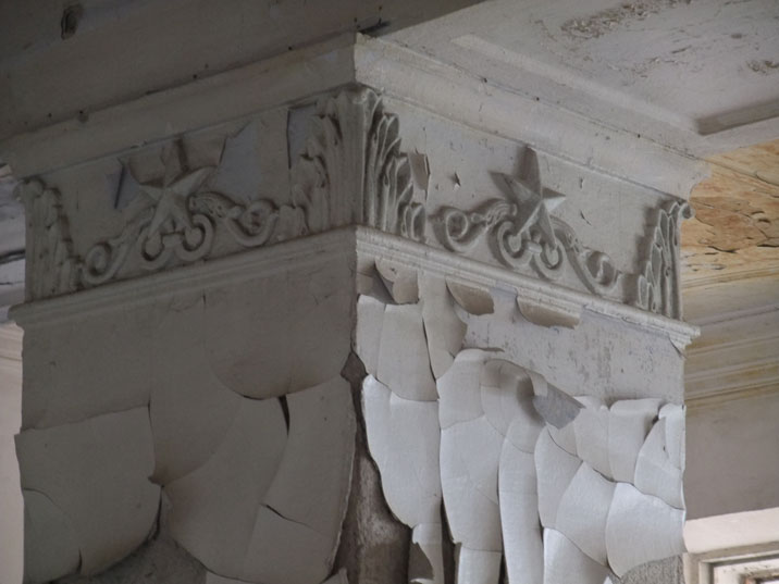 Columns decorated with Soviet stars, probably dating the 1950s testify of the importance of this administrative building