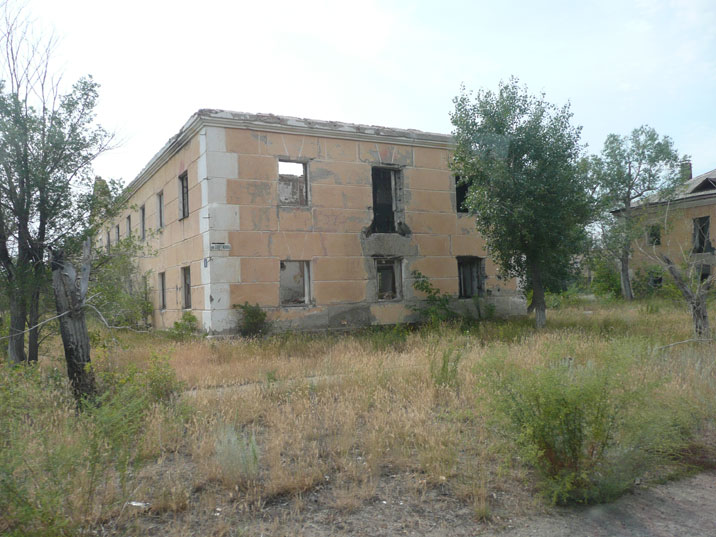 Abandoned housing blocks in Kurchatov with the outer walls still standing, roofs and windows have disappeared