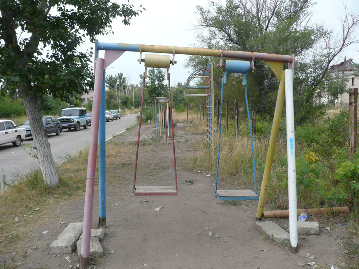 Swings at a Soviet era playground in the streets of Kurchatov
