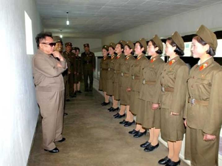 Kim Jong Il looking very interested at eight female soldiers