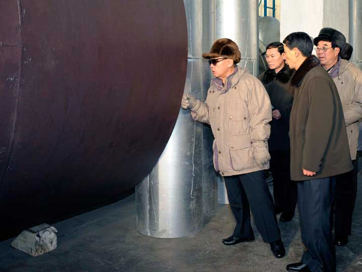 Kim Jong Il examines part of the Rakwon Machine Complex