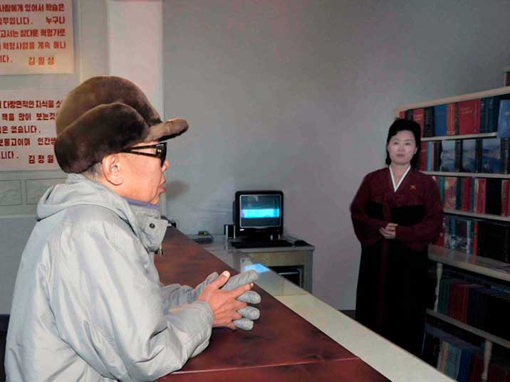Kim Jong Il in the library of the KPA Large Combined Unit 630