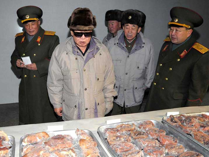 Kim Jong Il inspects pork products at the KPA'S October 7 Pig Farm