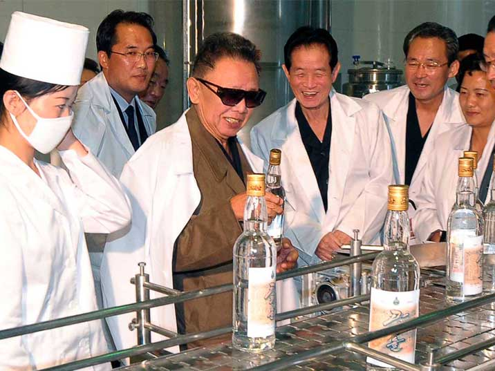 Kim Jong Il looking at liquor at Taedonggang Enterprises