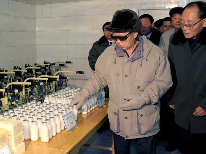 Kim Jong Il inspects milk at the newly built Kanggye farm