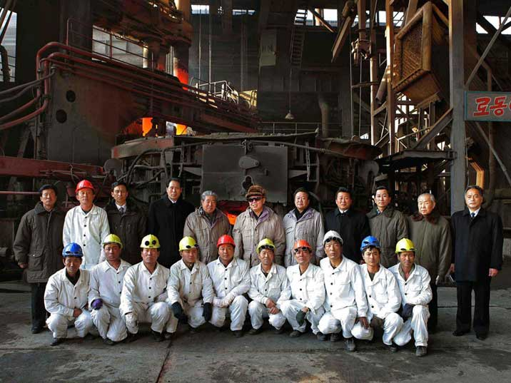 Kim Jong Il posing at the Hwanghae Iron and Steel complex