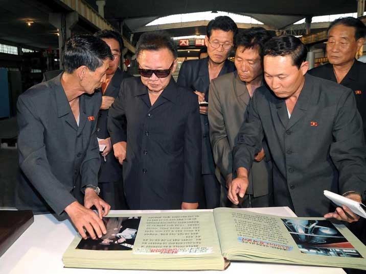 Kim Jong Il looking at a book in the Rakwon Machine Complex