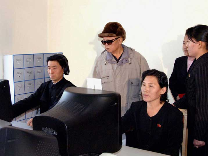 Kim Jong Il inspects a computer room of the Jagang library