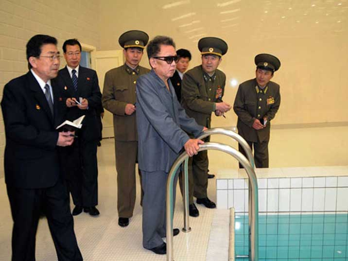 High ranking Army personnel show Kim Jong Il a swimming pool