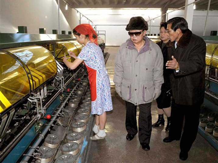 Kim Jong Il is explained how machines in a factory work