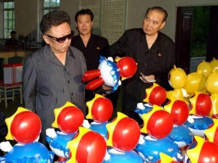 Kim Jong Il inspects colourful plastic toys in a factory