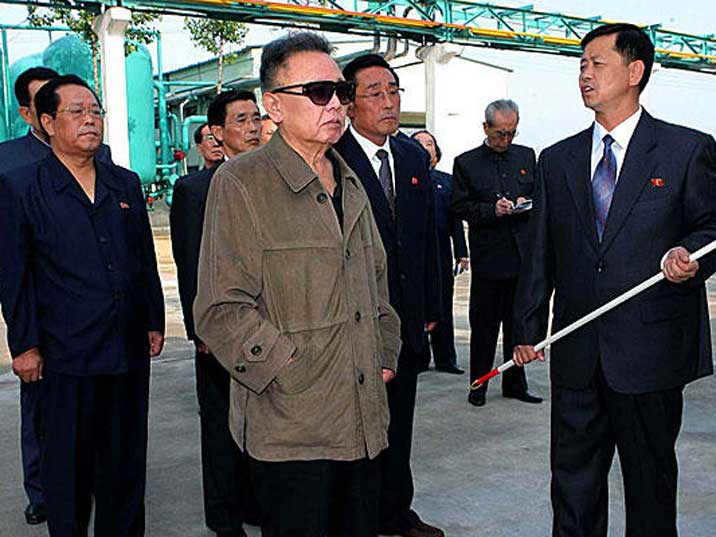 Kim Jong Il looking at a presentation in a chemical plant