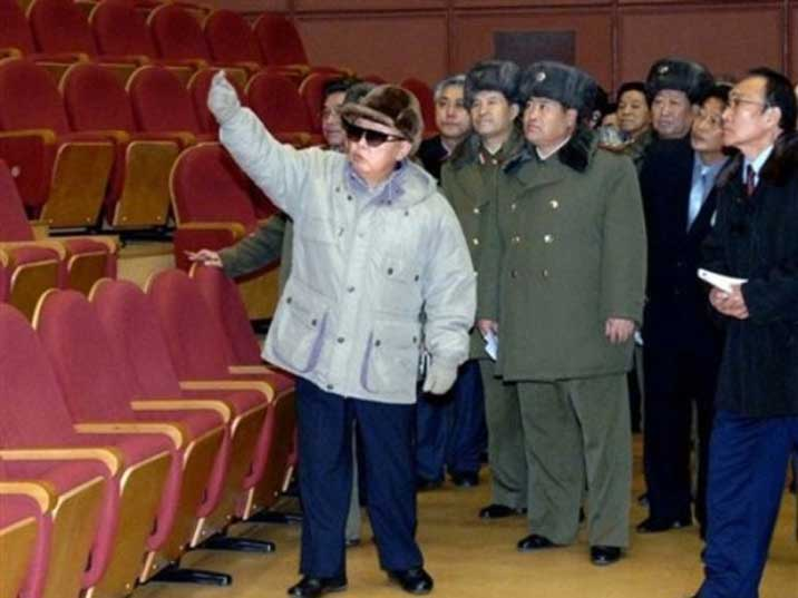 Kim Jong Il looking at chairs in a newly build Pyongyang theatre