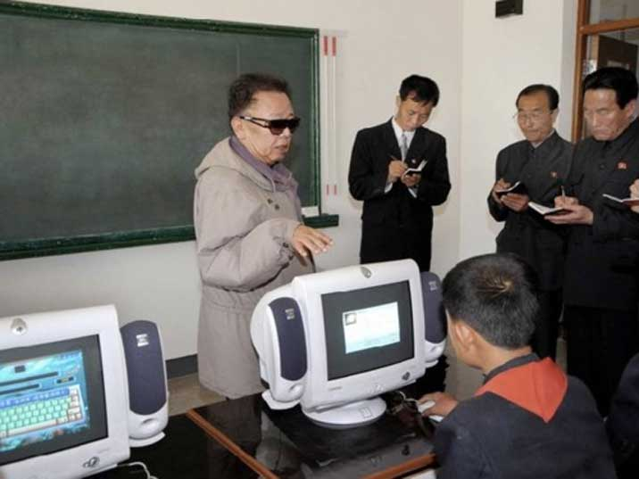 Kim Jong Il with field guidance on the operations of a computer