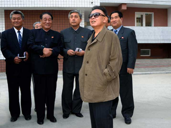 Kim Jong Il looking at newly build housing somewhere in the DPRK