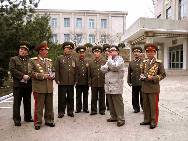 Kim Jong Il looking in the air while inspecting a KPA facility